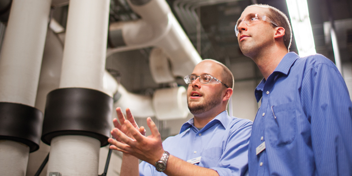 two field engineers evaluating downstream applications