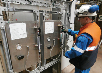 field engineer working with grab sample system